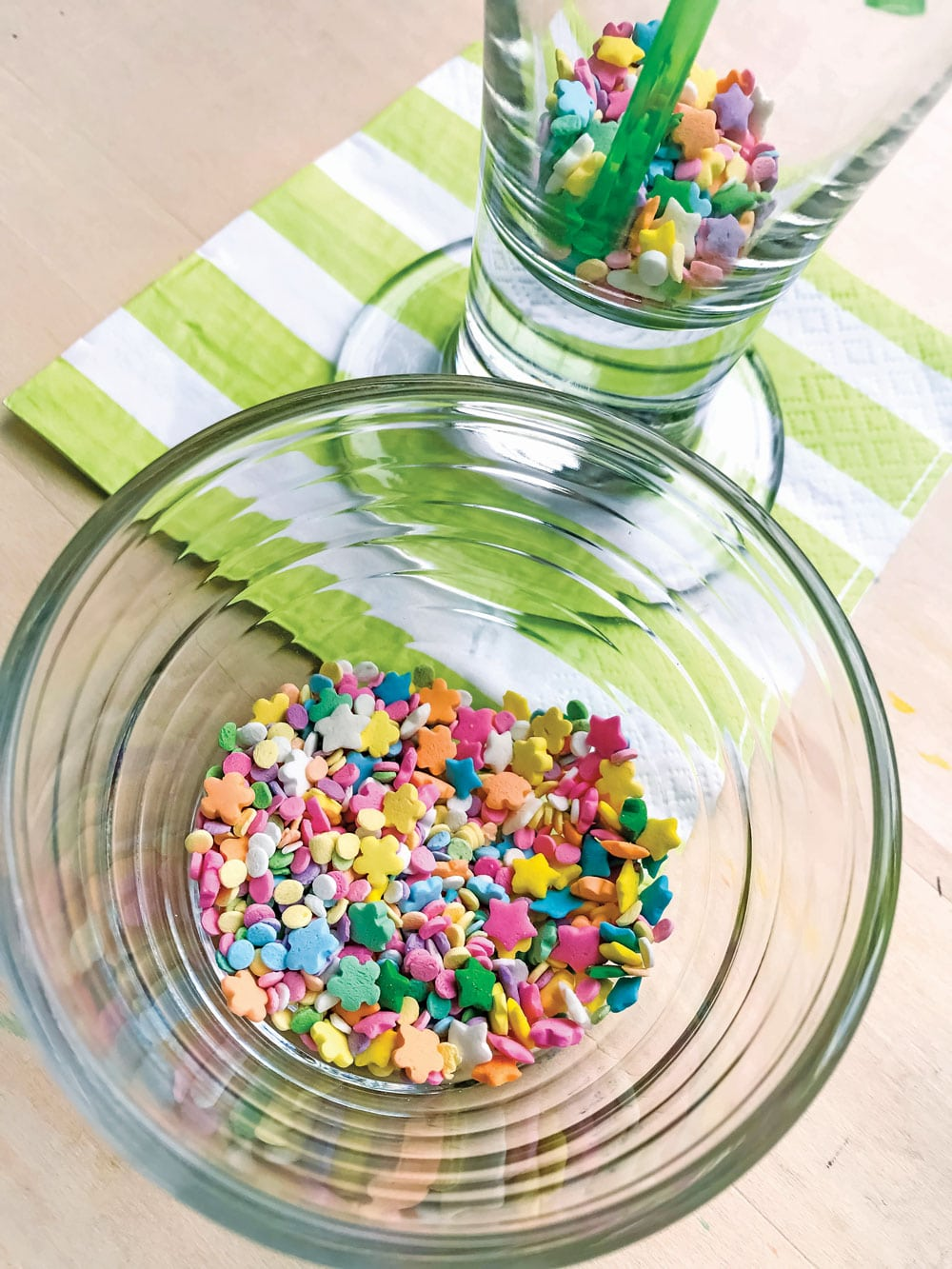 For an extra special St. Patrick's Day surprise, you can prep by covering the bottom of the glass with a layer of rainbow sprinkles, because this little trick NEVER fails to impress.