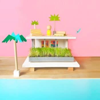 From just a few scraps of wood and simple supplies, you can make your own super-hip, mid-century-modern beachfront DIY up cycled dollhouse in an afternoon! | via barley & birch