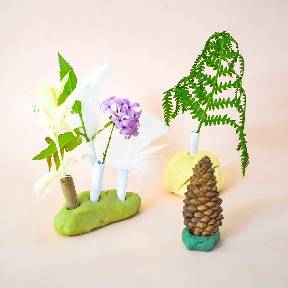 Kids will have fun making these lovely play dough and paper straw forests with supplies from the garden! A naturally wonderful way to practice fine motor skills with sensory play.