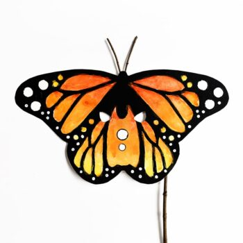 Use a fun painting technique to create a gorgeous DIY monarch butterfly mask with your kids. Just add wings for the most gorgeous homemade Halloween costume!