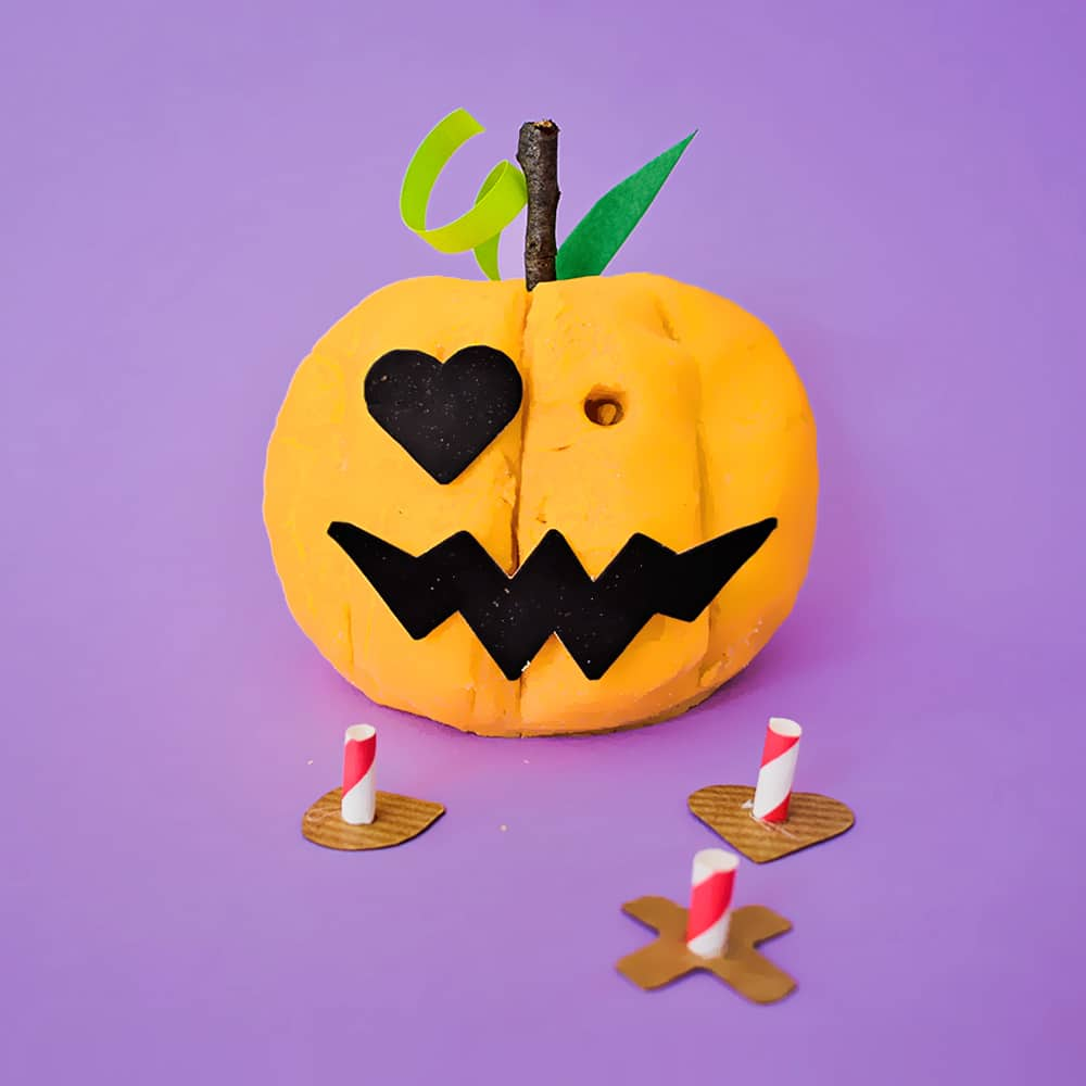 Celebrate Halloween with this fun build-your-own Jack-O-Lantern play dough activity for kids!
