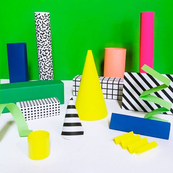 Our simple Memphis style-inspired DIY paper shapes are a fun way to introduce kids to sculpture, pattern, color and shapes! Cut, add, stack, paste, rearrange and more!