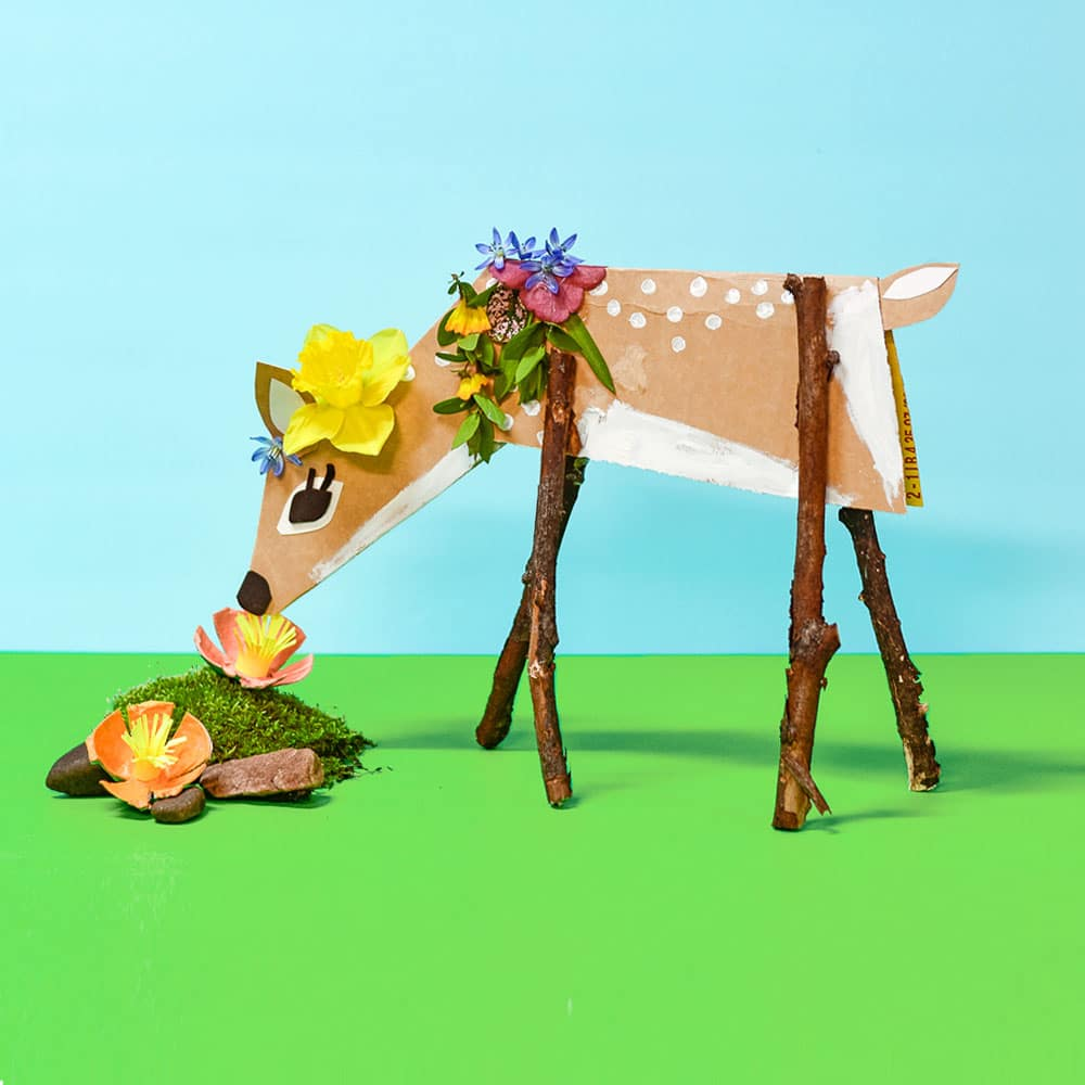 This sweet little spring cardboard deer craft for kids is a great way to recycle a cereal box and play with natural decorations from the garden!